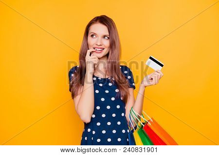 Charming Pretty Attractive Sexy Girl Having Bank Card In Hand And Finger Near Lips, Thinking About B