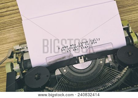 Motivational And Inspirational Life Quote Typed On Vintage Typewriter - A Man Who Lives Fully Is Pre