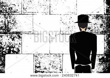 Western Wall, Jerusalem. The Wailing Wall. Religious Jewish Hasidim In Hats And Talit Pray. Black An