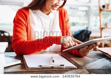 Beautiful Young Asian Business Owner Working With Computer And Tabet Smiling While Standing In Works