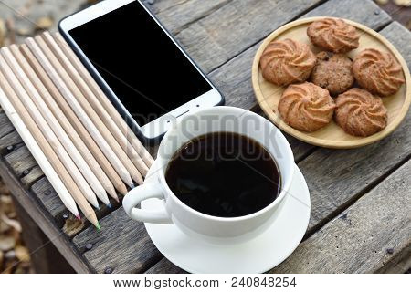 Top View Coffee Cookie On Wooden Table Copy Spec Texture Or Design And Concept