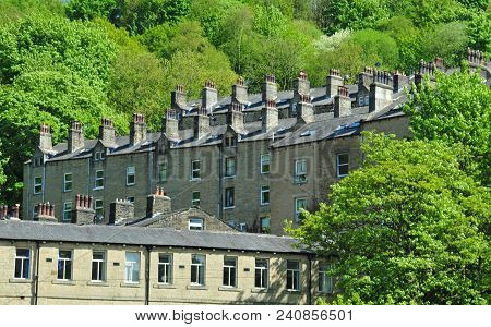 Hillside Streets Of Tall Stone Houses Set In The Woodland Landscape I Hebden Bridge West Yorkshire