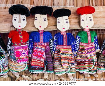 Row Of Black And Red Dzao Wooden Dolls Wearing Traditional Clothes, Can Cau Market, Northern Vietnam