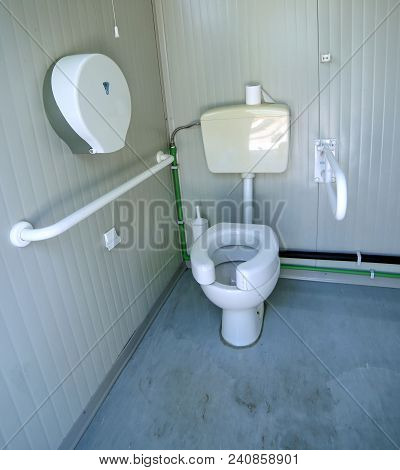 Disabled Bathroom With The Special Water Closet And Support Bar
