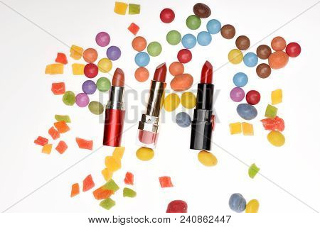 Red Lipsticks, Sweets, Dragee, Candy, Candied Fruit, Confetti. Festive Fashion Concept Flat Lay Top