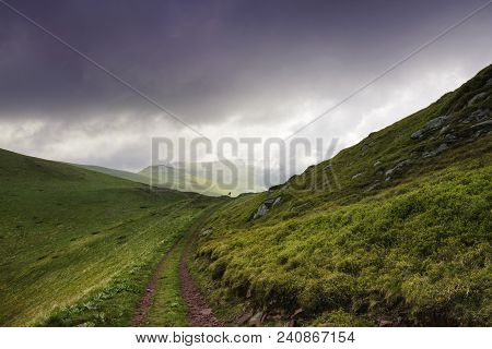 Mountain Landscape With Man Hiking Alone On The Horizon. Man Achieve Top Of The Mountain. Mountain L