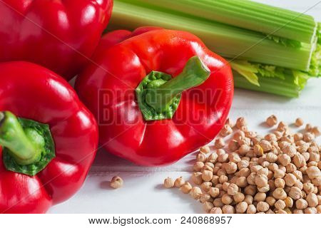 Red pepper celery chickpeas colored vegetarian foodstuffs. poster