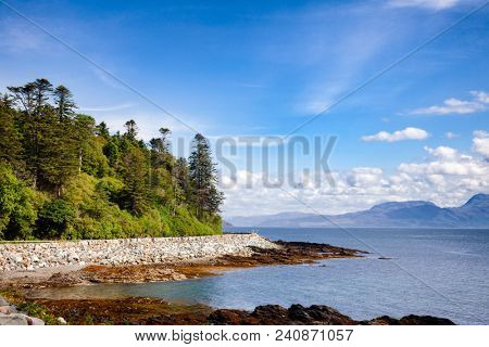 Scenic winding road along the Sleat peninsula coast of the Isle of Skye  overlooking the Sound of Sleat, a narrow sea channel off the western coast of Scotland, UK