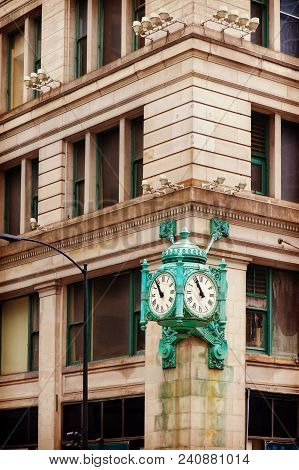 Marshall Field's Clock On State Street In Chicago, Usa