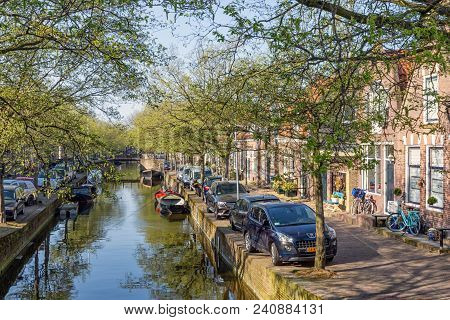 Enkhuizen, The Netherlands - April 20, 2018: Canal Dutch Historic City Enkhuizen With Cars Parked At