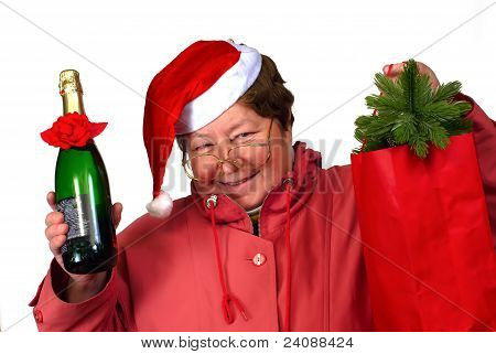 Mrs Santa Claus   Santa Woman Dressing Up In Red Christmas Costume Is Holding Red Sack With Gifts.