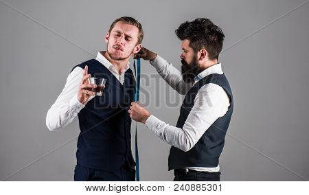 Young Businessman Visit Tailor. Man With Beard Busy With Measuring Process. Tailor Measuring Client