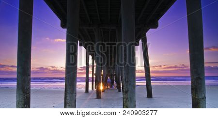 Violet: Sunrise Over Atlantic Ocean At Amelia Island Fishing Pier, Jacksonville, Florida