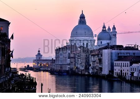 Cathedral In Venice, Italy Over The Grand Canal At Sunrise