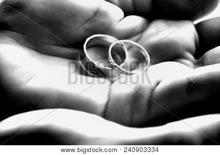 Paired: Set Of Rings In Hands In Black & White