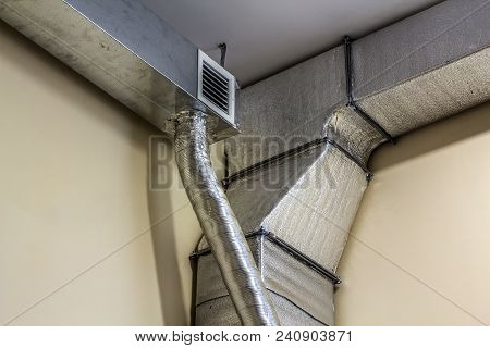 Industrial Air Duct Ventilation Equipment And Pipe Systems Installed On Industrial Building Ceiling.