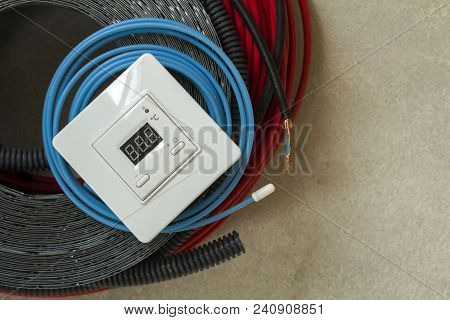 Heating Floor System Wires, Cables And Control Panel. Renovation And Construction Concept. Comfort H