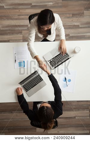 Top View Of Two Female Associates Or Ceos Handshaking Greeting Each Other Or Making Agreement And St