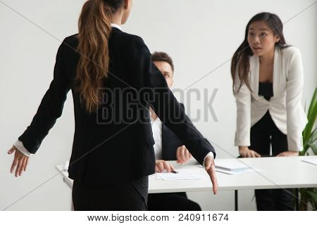 Female Worker Is At Loss Shrugging Shoulders, Being Blamed By Colleagues Presenting Her Arguments, A