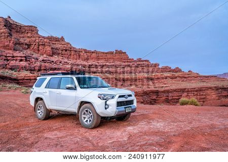 Moab , UT, USA - May 6, 2018:  Toyota 4runner SUV (2016 trail edition, stock vehicle without any off road modifacations)) on a desert trail before sunrise in the Moab area.