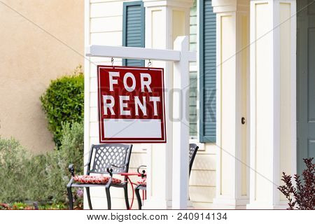 Red For Rent Real Estate Sign in Front House.