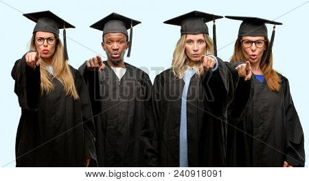 Education concept, university graduate woman and man group pointing to the front with finger