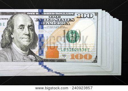 Dollars money cash on black background. Heap of money