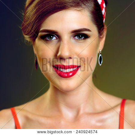 Pin up girl happy and smiling at party. Pin-up retro female style. Girl style wearing red dress. How to properly make up lips. Photo with red color lips accent. Portrait of beautiful laughing girl.