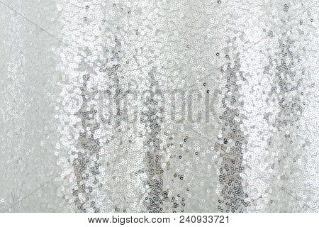Silver Sequins Pattern Texture Fashion Background. Horizontal Close-up Shot