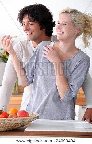 couple laughing in the kitchen