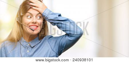 Consultant of call center woman in headphones terrified and nervous expressing anxiety and panic gesture, overwhelmed