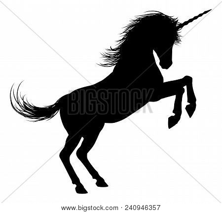 Unicorn Mythical Horse In Silhouette Standing On Hind Legs