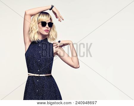 Blonde Girl In Elegant Dress. Creative Studio Concept Portrait. Fashion Young Woman In Stylish Outfi
