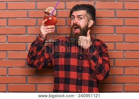 Bartender Recommends To Try Beverage. Man In Checkered Shirt Shows Thumb Up Gesture, Brick Wall Back