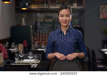 Portrait Of Pretty Vietnamese Waitress With Empty Tray