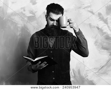 Bearded Man, Long Beard. Brutal Caucasian Serious Hipster With Moustache Holding Blue Coffee Cup And