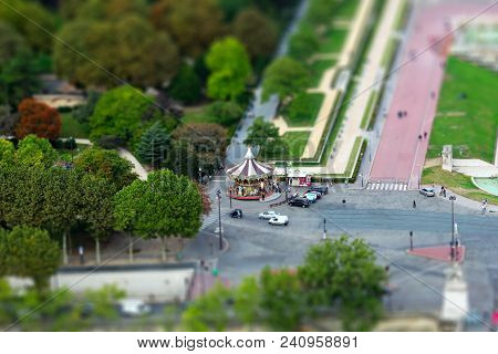 View Of The Children's Merry-go-round From The Eiffel Tower. Paris France. Miniature Tilt Shift Lens