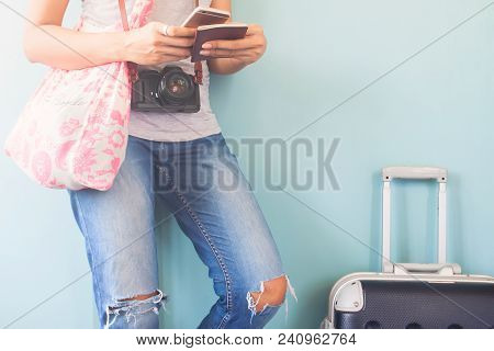 Woman Traveler Using Smart Phone And Passport Book With Traveler Suitcase, Happy And Travel Lifestyl