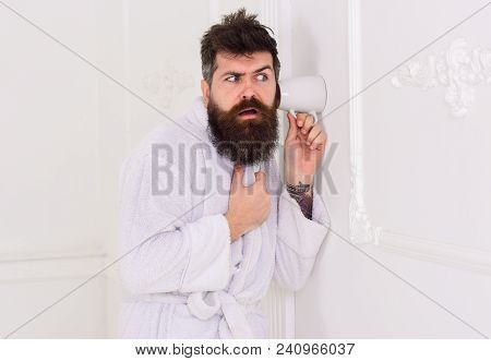 Man In White Interior Spying, Eavesdropping. Secret And Spy Concept. Man With Beard And Mustache Eav