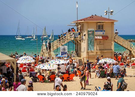 Tel Aviv, Israel. April 19, 2018. Tourists And Swimmers At The Famous Tel Aviv Geula Beach With A Sa