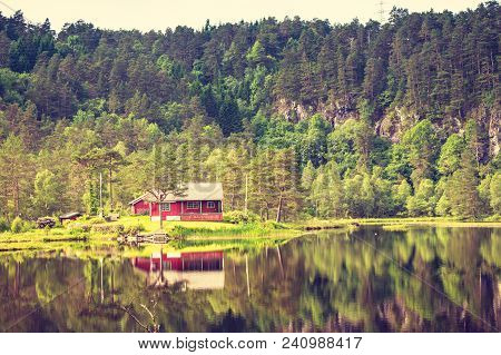 Wooden Cabin Hytte In Norwegian Green Forest On Water Lake Shore. Beautiful Landscape In Norway, Sca