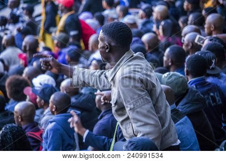 Cape Town, South Africa, 12 May 2018 - Diverse South African Football Supporter Arguing With A Decis