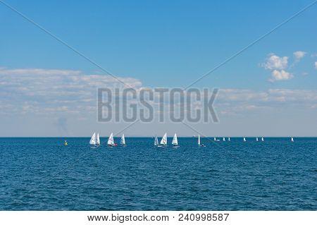 Melbourne, Australia - April 6, 2017: Sailing Boats With White Sails In The Ocean. Sailing Club Trai