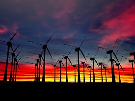 Black Wind Turbines Field On A Sunset Background At Evening Time