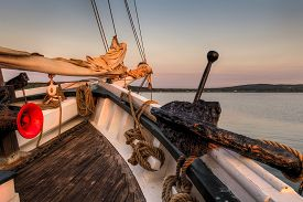Bow Of 101 Year Old Sailboat With Anchor - On Historic Wooden Schooner