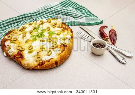 Italian Focaccia With Three Types Of Cheese, Green Olives, Hot Chili Pepper And Parsley