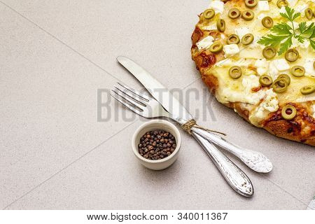 Italian Focaccia With Three Types Of Cheese, Green Olives, Black Pepper And Parsley