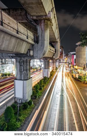 Traffic on Rama I street at Pathumwan junction in Bangkok, Thailand. Pathumwan junction is one of the most busiest shopping districts in Bangkok