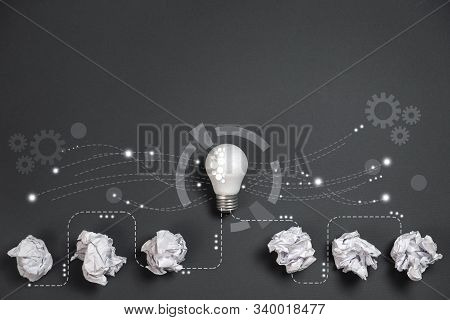 Innovation Concept. Crumpled Office Paper And White Light Bulb Future Technologies And Network Conne