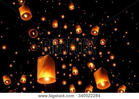 Swarms Of Sky Floating Lanterns Are Launched Into The Air During New Year's Eve And Yee Peng Lantern